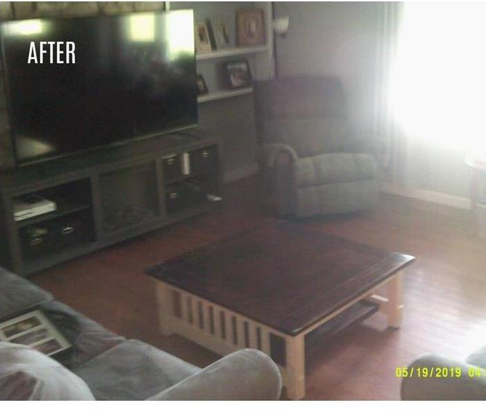 Same living room cleaned up with no remaining debris
