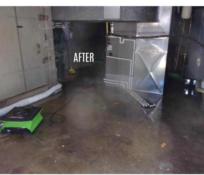 Clean concrete floor in basement and one fan